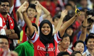 Arsenal fans show support on a club tour to Malaysia. Photograph: David Price/Arsenal FC via Getty Images